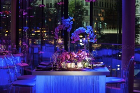 Custom table fringe pairs magically with deep blue lighting and modern floral.