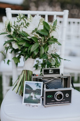wedding ceremony white chair bridal bouquet with old polaroid camera vintage antique wedding rings