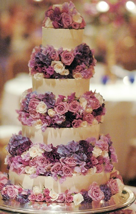 Four layer wedding cake with fresh rose and hydrangea