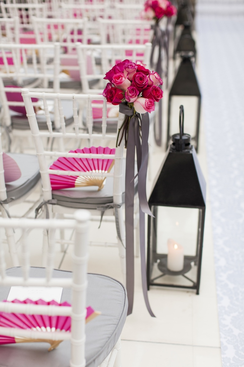 White ceremony aisle with black lanterns and roses