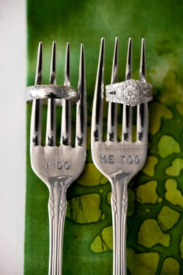 "Wedding rings on forks with ""I Do"" and ""Me Too"" stamps"