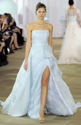 Asymmetrical column with drape detail at waist and painted floral Organza.
