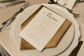ivory wedding menu with gold lettering, clever wedding hashtag on menu