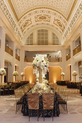 renaissance hotel cincinnati wedding with tall round ceiling and golden painted details