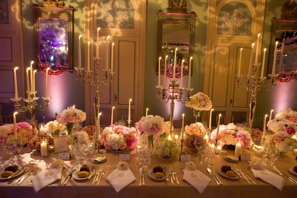 Candlelit Italian banquet hall and tables