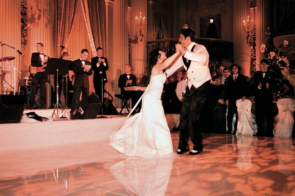 Bride and groom dancing to wedding band