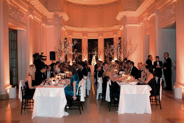 Two king tables with white linens at mansion wedding