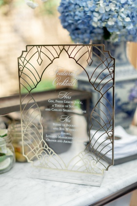 lucite and metallic cocktail hour menu with art deco pattern