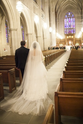 Bride walking down aisle with father of bride