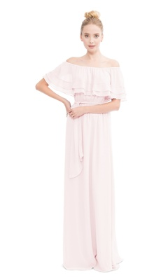Ruffled off the shoulder gown with optional tie at waist.