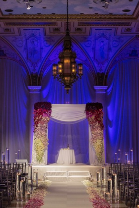 The Breakers ballroom wedding ceremony with purple lighting