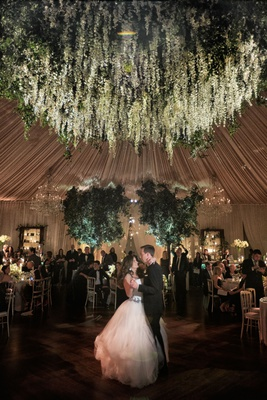 wedding reception tented ballroom reception bride in vera wang ball gown flower chandelier overhead