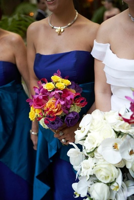 Bridesmaid holding vibrantly colored flowers