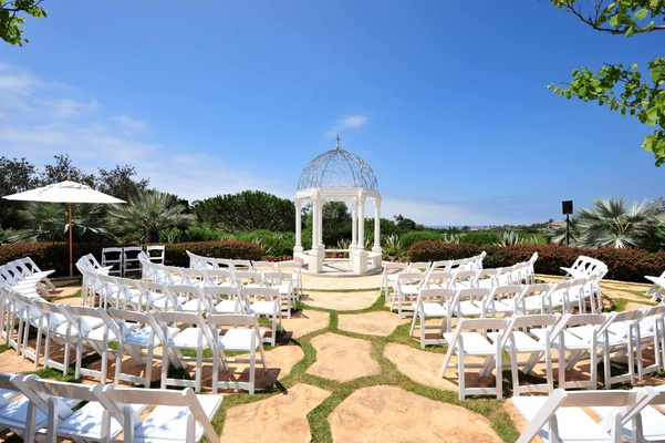 Curved rows of chairs and garden gazebo