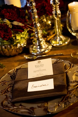 Elegant menu tucked into brown dinner napkins