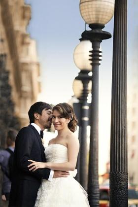 Hispanic woman and Asian man on wedding day
