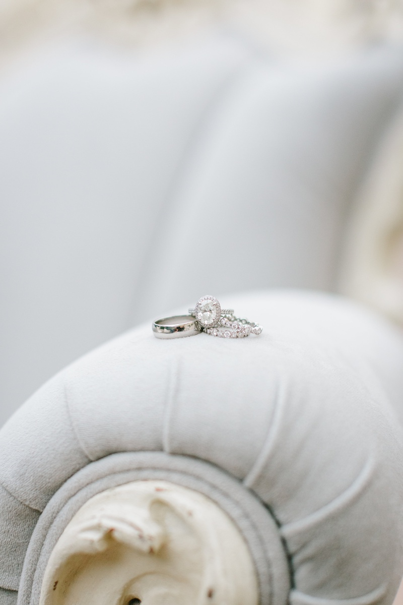 plain white gold band for groom, oval diamond halo engagement ring, two eternity bands