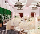 ojai valley inn ballroom wedding reception with faux hedge wall and industrial chandeliers