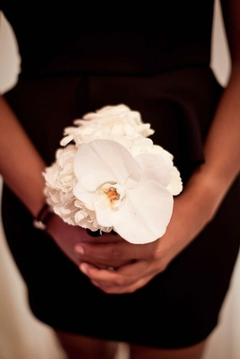 African-American woman holding white bouquet