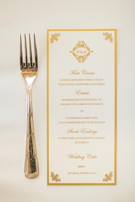 Menu with gold border and monogram motif