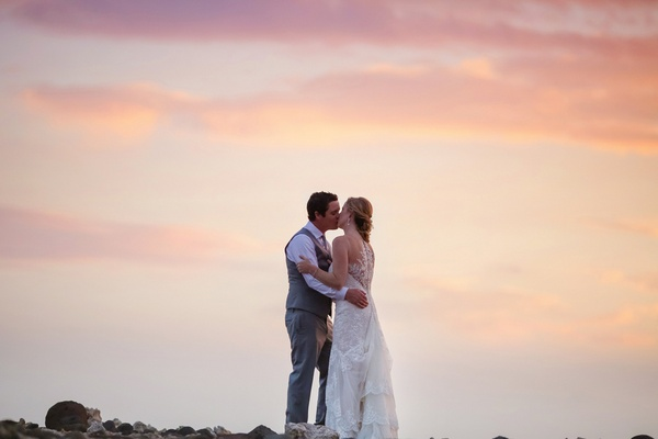 bride and groom kiss at sunset, maui wedding