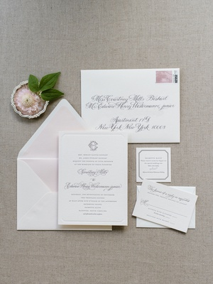 The Lettered Olive wedding invitation suite light pink envelope liner grey calligraphy monogram