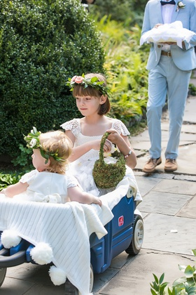 wedding ceremony outdoor blue wagon flower girls flower crown lace dress moss basket