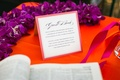 Guest book sign with dictionary for guests to find a descriptive word for the couple
