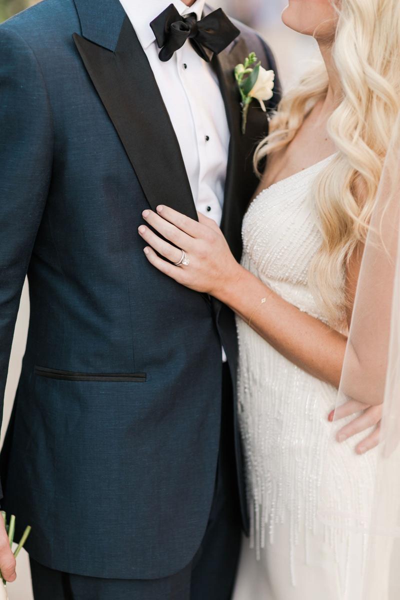 wedding portrait close up engagement ring beaded wedding dress navy suit black lapels bow tie