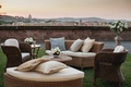 couches and chairs on lawn overlooking view of Rome