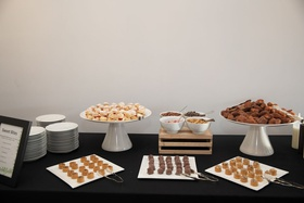 table with bite-sized desserts at bridal shower