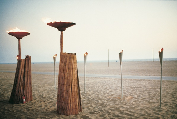 fire torches and lamps on sand