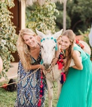 Wedding in Mexico destination event rehearsal dinner welcome party guests posing with donkey in poms