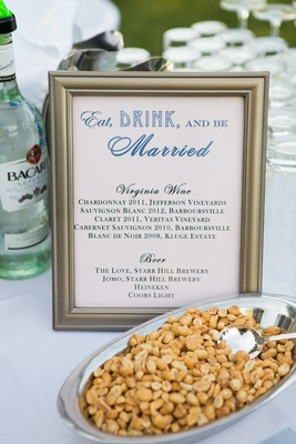 Roasted peanuts at wedding bar with framed menu