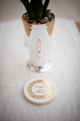 White and gold greek pattern coaster with cute wedding saying