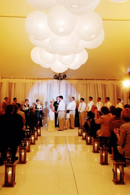 Tent wedding ceremony with paper lanterns