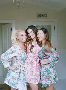 Bride of Adam Ottavino in pink robe with maid of honor and matron of honor in flower print robes