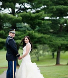 Bride in Vera Wang high-neck gown and groom in dress blues uniform