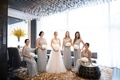 Bride in wedding dress with bridesmaids in v neck adrianna papell dresses from bhldn sequin beads