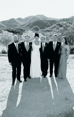 Black and white image in Malibu of bride with guests