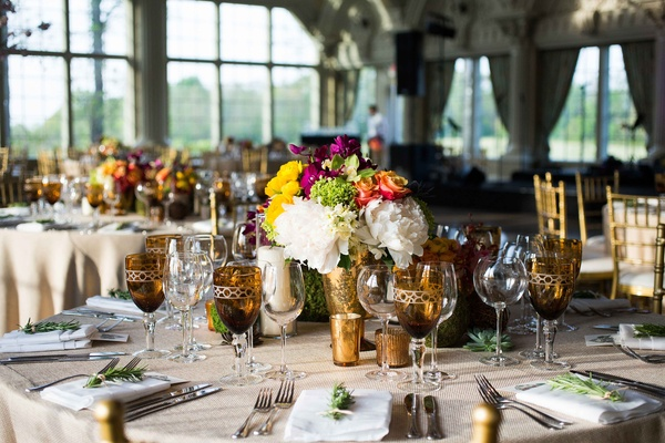 rustic reception, amber mercury-glasses and water goblets  glass windows