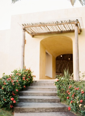 Wedding rehearsal dinner welcome party hotel in Sayulita Mexico greenery flowers stairs and natural