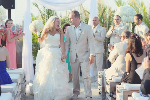 b5b73e87b8507 ... of bride · Bride in Maggie Sottero gown with groom in tan suit leave  ceremony ...