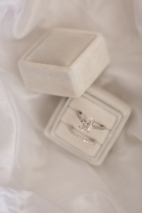 wedding ring pave diamonds oval cut engagement ring solitaire platinum white gold band grey velvet