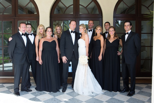 Bride and groom with bridesmaids and groomsmen in black