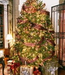 Holiday wedding at the Pleasantdale Château with a Christmas tree with ribbon, golden lights