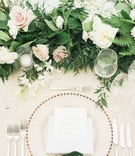 wedding reception greenery garland pink white rose calligraphy on green leaf gold charger plate