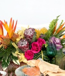 wedding reception styled shoot tropical theme protea flowers roses cabbage bird of paradise