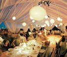 Evening reception decorations for beach tent wedding