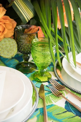 tropical wedding inspiration table setting, bright green goblet, dark green goblet